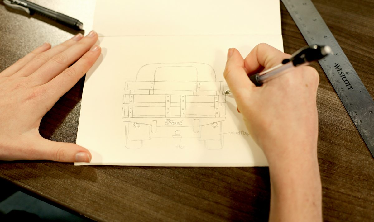 Shannon sketches a truck